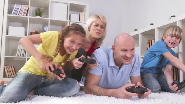 HD DOLLY: Family Having Fun Playing Video Games video
