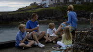 Family Having Ice Cream At The Harbour. video