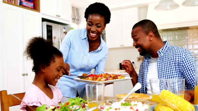 Family having meal on dinning table at home video