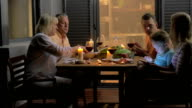 Family having supper on outdoor house terrace video