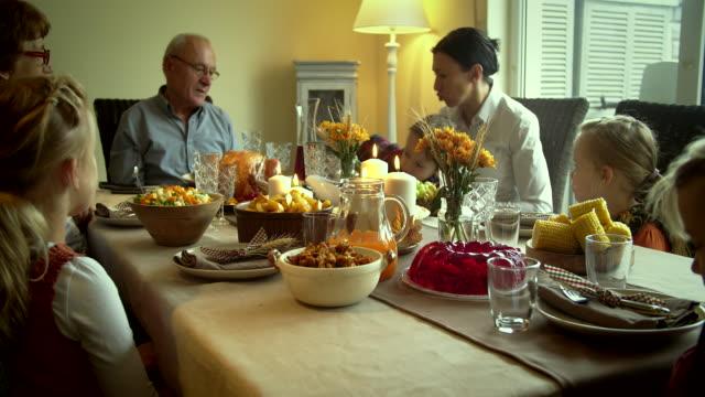 Family Having Traditional Holiday Stuffed Turkey Dinner - 4k Video video