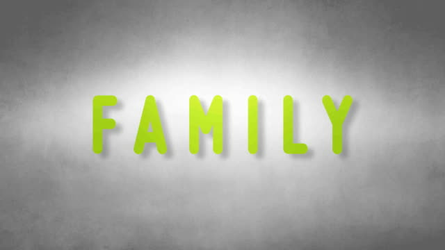 Family headband. Text from sand. With black background video