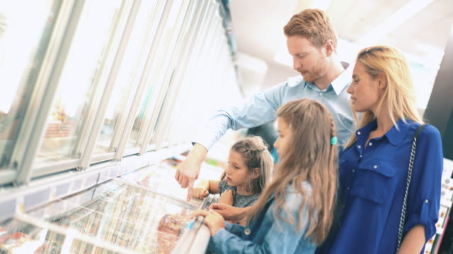 Family in a supermarket, 4k video