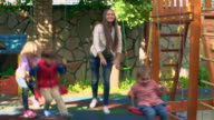 Family in Backyard Playground video