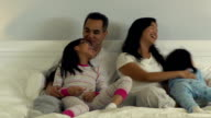 Family in bed together video