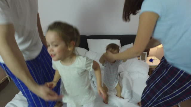 Family in bed video