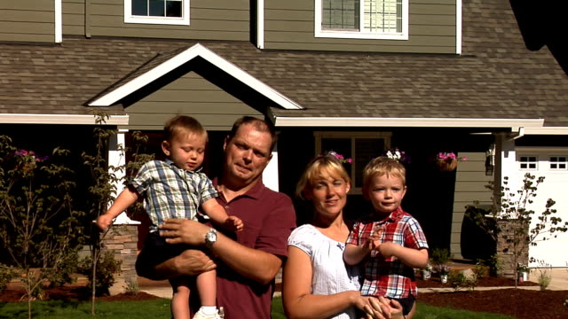 Family in front of home video