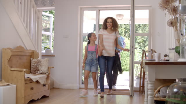 Family In Hallway Returning Home Together video