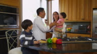Family in kitchen together, dolly movement video