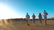 Family Jogging on the Beach video
