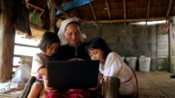 Family Karen enjoys learning to use a laptop,Dolly shot video