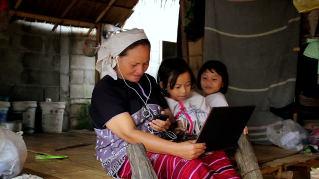 Family Karen enjoys learning to use laptop and smart phone video