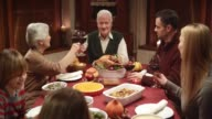 Family making a toast at the Thanksgiving dinner video