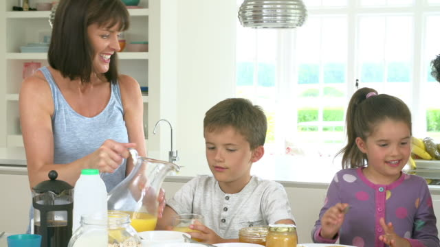 Family Making Breakfast In Kitchen Together video