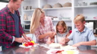 Family Making Pizza In Kitchen Together video