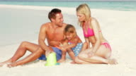 Family Making Sandcastle On Beach Holiday video