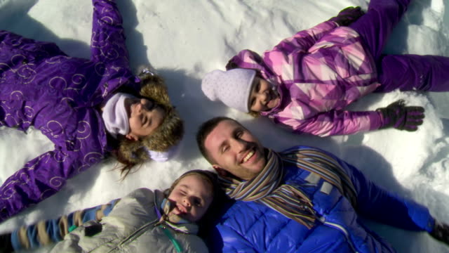 HD CRANE: Family Making Snow Angels video