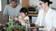 Family making together a lunch in kitchen on a holiday video