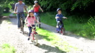 Family On Cycle Ride In Countryside video