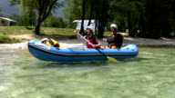 Family on mini raft passing camp video