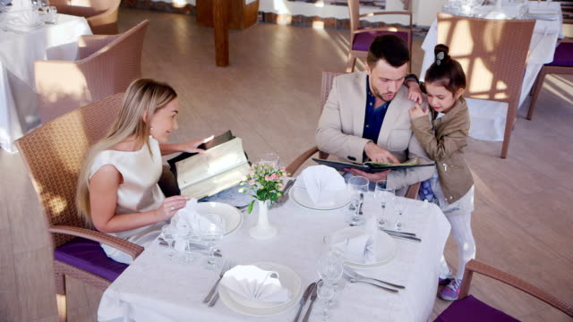 Family ordering dinner in a cafe or restaurant. The top point of shooting video