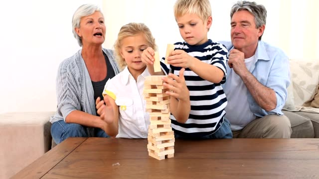 Family playing a game video