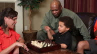 Family playing chess together video