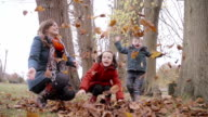 Family Playing In The Autumn Fall video