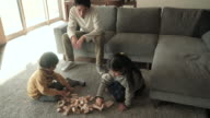 Family playing in the block of wood in the living room video