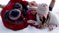 Family playing in winter snow video
