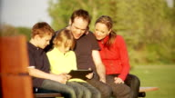 Family plays on a tablet together video