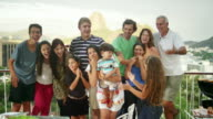 Family posing for a portrait at a Brazilian family BBQ video
