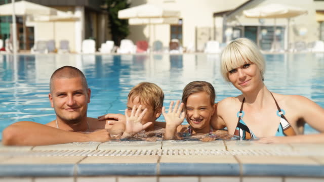 HD DOLLY: Family Posing In Swimming Pool video