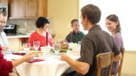 Family prays at Thanksgiving diner video