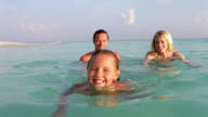 Family Relaxing In Tropical Sea video