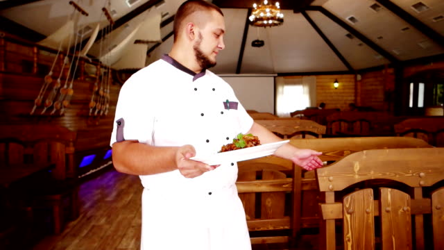 Family restaurant, portrait, chef are served food to guests, the hall tavern, cafe, European traditions, chef out to visitors, carries the food on a plate video