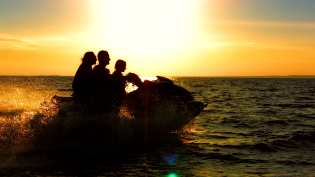 SLO MO Family Riding A Jet Boat At Dusk video