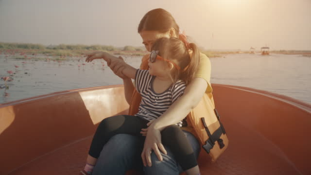 Family Riding In The Boat video