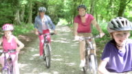 Family Riding Mountain Bikes Along Track video