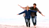 Family running with arms outstretched video