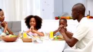 Family saying grace before eating video
