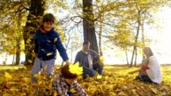 SLO MO Family scattering leaves over each others video