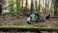 Family Setting Up Tent In Woods video
