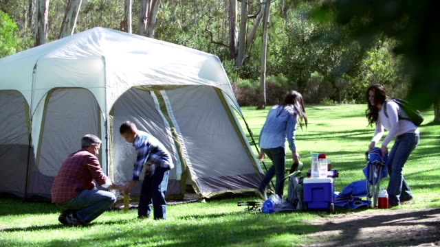 Family Setting Up Tent On Camping Holiday In Countryside video