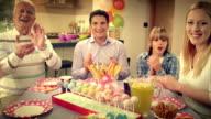 POV family singing happy birthday to grandma video