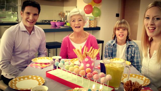 POV family singing happy birthday to grandpa video