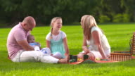 HD DOLLY: Family Singing While Having A Picnic video