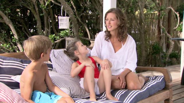 Family sitting in garden video