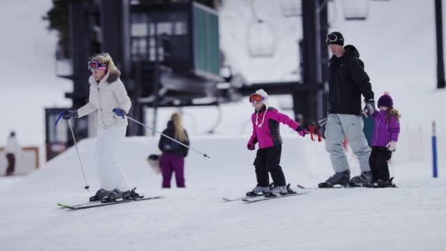 Family Snow Skiing at a Ski Resort video