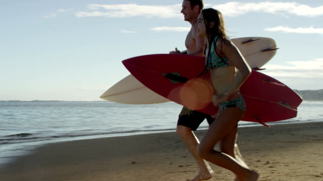 Family surfing on a tropical beach vacation to Hawaii video